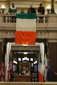 Irish flag draped over the rail in the Wisconsin Capitol rotunda.  Photo by Callen Harty.