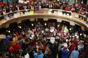 "Protesters inside the Wisconsin Capitol rotunda on February 16, 2011, just days after new governor Scott Walker introduced his controversial ""budget repair bill"".  Photo by Callen Harty."