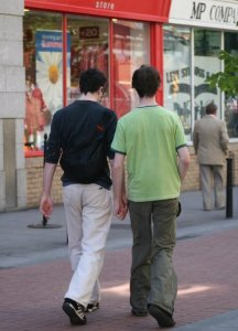 A couple of young men hold hands near St. Stephen's Green, Dublin. Photo by Callen Harty.